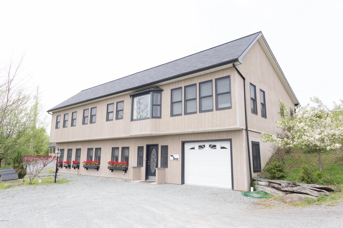 RECENTLY REDUCED!! If You Are Finding Yourself In Need of a Mother/Daughter Home This Is the Home For You! Bright and Beautiful, This Custom Contemporary Home Has a Beautiful Floor Plan that Flows Just Right. Featuring a Total of 5 Bedrooms and 3 Bathroom