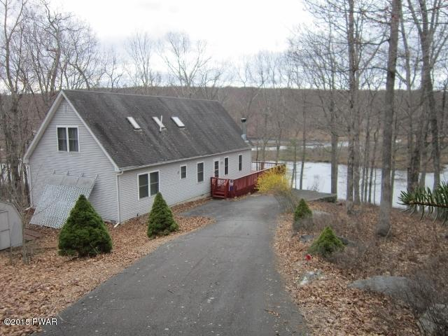 RECENTLY REDUCED!! ~~~Masthope Mountain Lakefront~~~ This Waterfront Chalet Home Features 4 Bedrooms & 3 Bathrooms. Cathedral Ceilings and a Loft Give This Home an Open and Airy Feeling! Perfect for Year Round Living or As a Vacation Home; Located in Amen