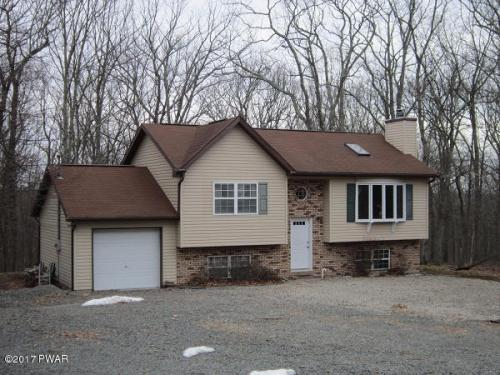 NEW LISTING!! This Cozy Bi-Level Located in Masthope Mountain Could Be Your Perfect Vacation Home! Located Within Walking Distance of Many Amenities, Including the Beach. This Home Features 4 Bedrooms, 2 Bathrooms, a Large Family Room, and a Spacious Deck