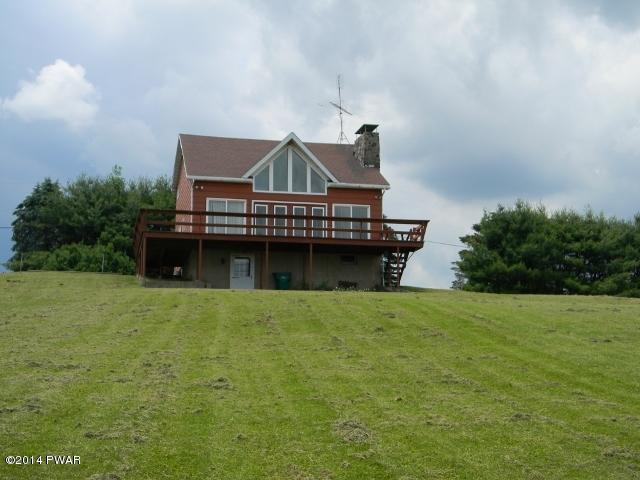 NEW LISTING !! Beach Lake Chalet, Private Setting on 2.18 Acres,Oak Hardwood Floors, Full Basement, Wrap Around Deck, Stone Fireplace