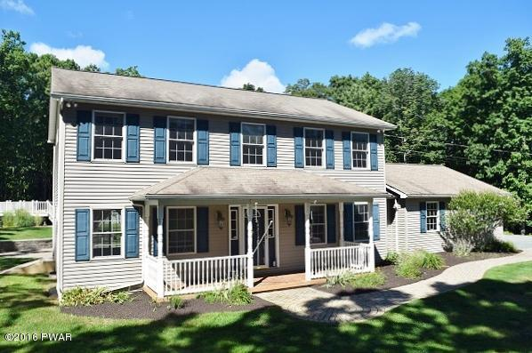 NEW LISTING!!! This Impressive Colonial Home is 3500+ Square Feet of Quality and Features 4 Bedrooms and 3 Bathrooms!! Not Located in a Community, Private AND has Deeded Lake Rights to Lake Wallenpaupack on Route 390. This Home just about Has it All; Upsc