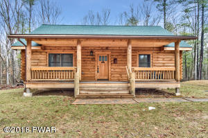 """NEW LISTING!! Beautiful Log home situated on 3 acre lot! Featuring high cathedral ceilings with wide plank flooring and whole 10"""" logs. This ranch offers the perfect blend of a true log cabin with a modern touch!"""