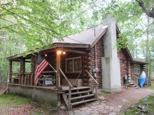 NEW LISTING!!! Real Log Home Nestled in the Woods but Close to the Superb Amenities Masthope has to Offer! Featuring 3 Bedrooms and 2 Bathrooms; Recently Remodeled Roomy Living Room with an Impressive Stone Faced Fireplace, 3 Heating Sources, and a Cozy C