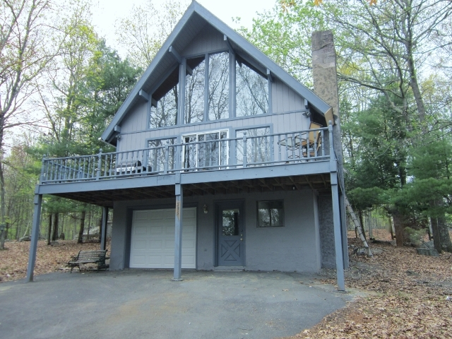 RECENTLY REDUCED!! This Masthope Mountain Chalet Features a Beautiful Wall of Windows That Allows Lots of Natural Light Into This Home! The 3 Bedrooms and 2 Newly Renovated Bathrooms Gives You and Your Family Plenty of Space to Stay Here. Lots of Decking