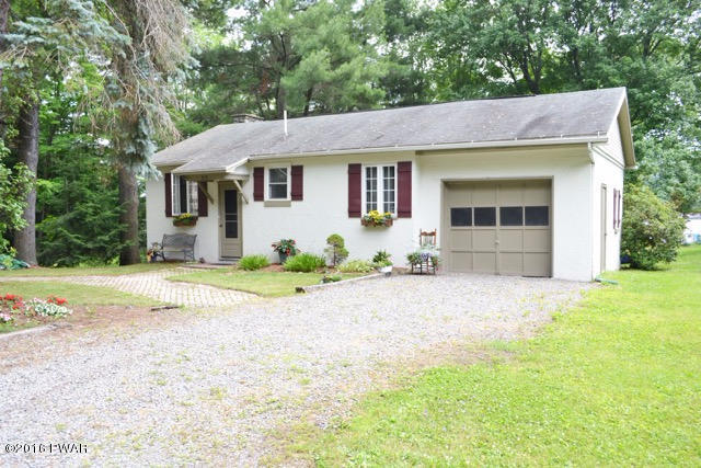 NEW LISTING!!! This Charming 1950's 2 Bedroom, 1 Bathroom Cottage is Located on the Prestigious Lake Ariel! Starring the Updated Bathroom with a Jetted Tub, a Knotty Pine Kitchen, Stone Fireplace, and Hardwood Floors! Appreciate the Beauty of the Lake fro