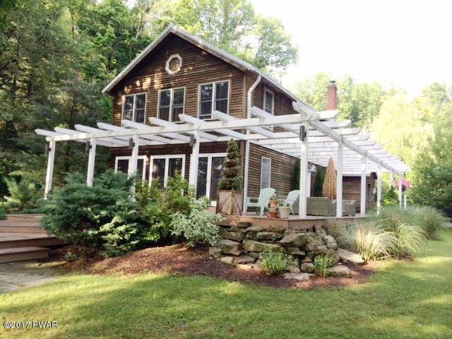 Recently Reduced !!! This Lake Ariel Lakefront Home Has All The Rustic Charm Imaginable. 5 Bedrooms, 2 Baths, 3 Car Garage with Bedroom / Studio above , Wrap Around Deck and an Outdoor Shower are just a few of the Home's Many Features . Come Take a Look a