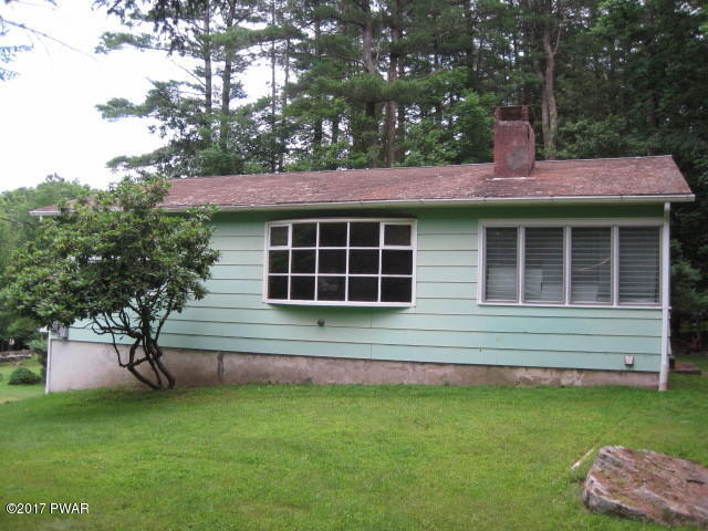 NEW LISTING!! This Vintage Cottage Located in Sandy Shore Community Offers 2 Bedrooms and 1 Bathroom; Perfect for a Starter Home or Even For Your Poconos Retirement Home! Some of the Features of This Home Include Hardwood Floors, Sun Room, Central A/C, &