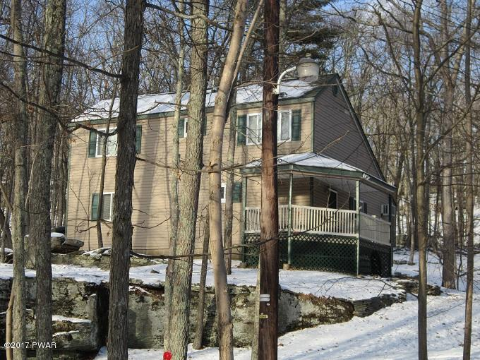 NEW LISTING !! Masthope Mountain Chalet....This home backs Masthope ''forever green lands'' Featuring Vaulted Ceilings, Living Room Fireplace, Screened Porch, 3 Bedrooms and 2 Baths. Plus All the Amenities Masthope Mountain has to Offer !!! Come Take a Lo