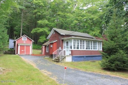 NEW LISTING!! This Private Cottage Getaway is the Last Home on the Street in Hawley Boro. Surrounded by Woods, This Home Can Offer You the Quiet You See from Everyday Life! The Kitchen and Living Room Have Had Many Recent Updates. This Home Offers 1 Bathr