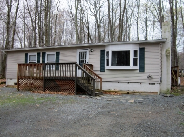 NEW LISTING!! This Inviting Ranch Located in Paupackan Lake Estates Features 3 Bedrooms and 1 Bathroom. The Wood Stove in the Living Room Adds a Coziness To This Home and the Flat Half Acre Lot the Home Sits on Gives You the Tranquility Associated with th