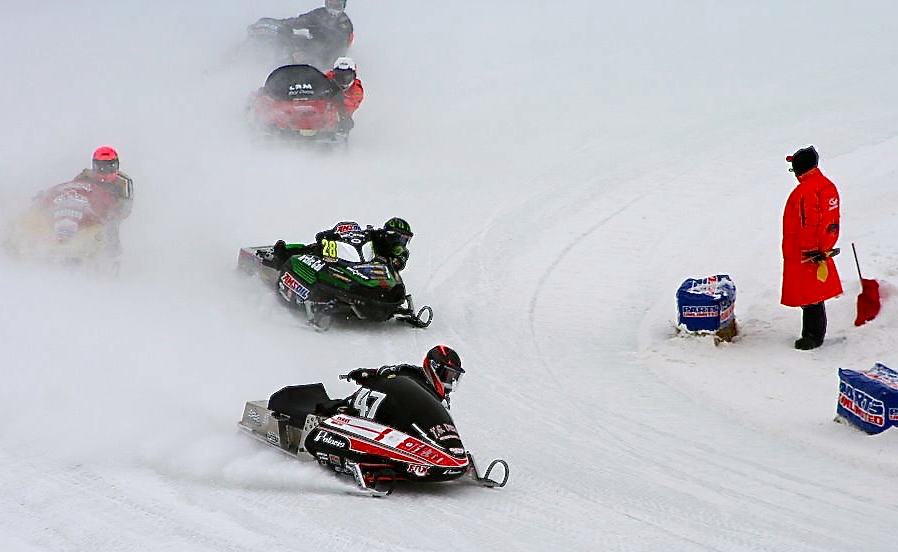 The roar of engines and flying snowmobiles in Eagle River