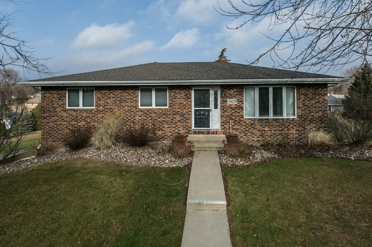 All brick ranch on large lot at 10279 Dixie Drive.  Updated with 4 seasons room!