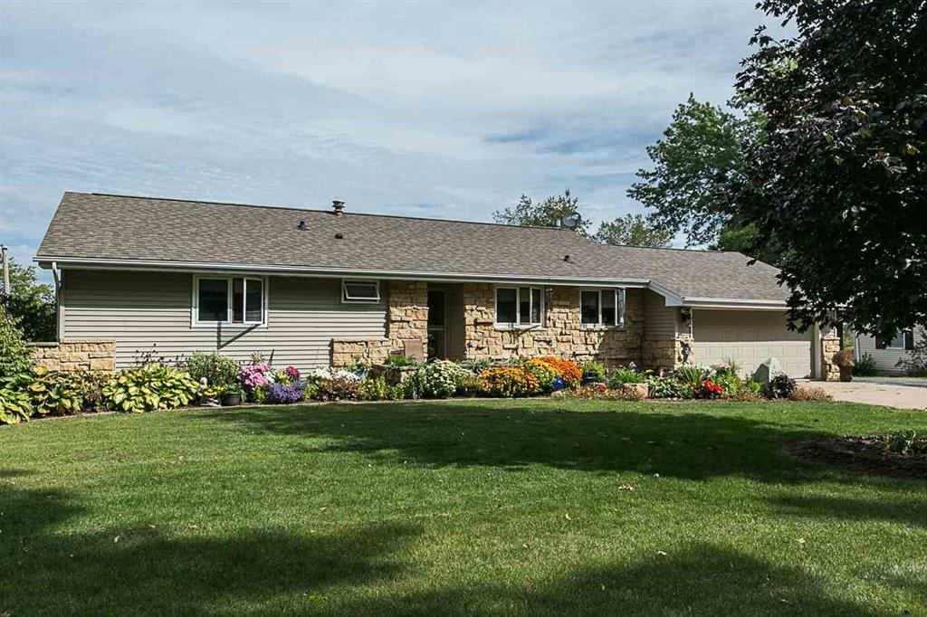 Home with an outbuilding, 4 garages, walk out ranch and no covenants $232,000