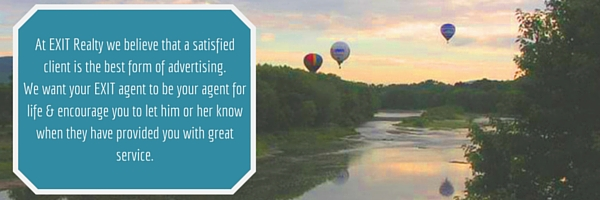 Hot air balloons floating over river