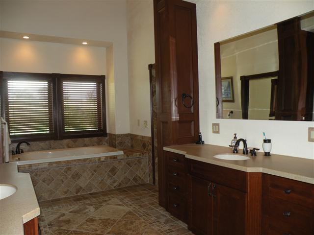 cherry and granite master bathroom