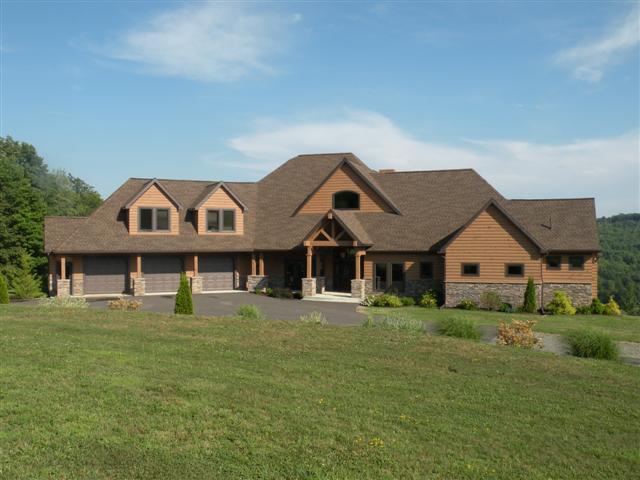 Contemporary log and stone home