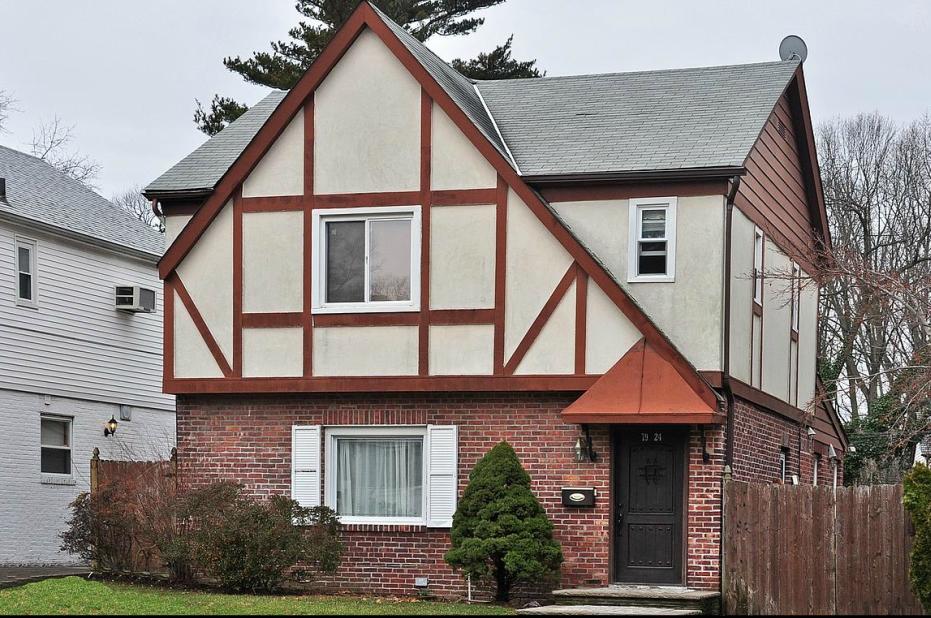 Hollis hills detached tudor home for sale for Tudor style homes for sale