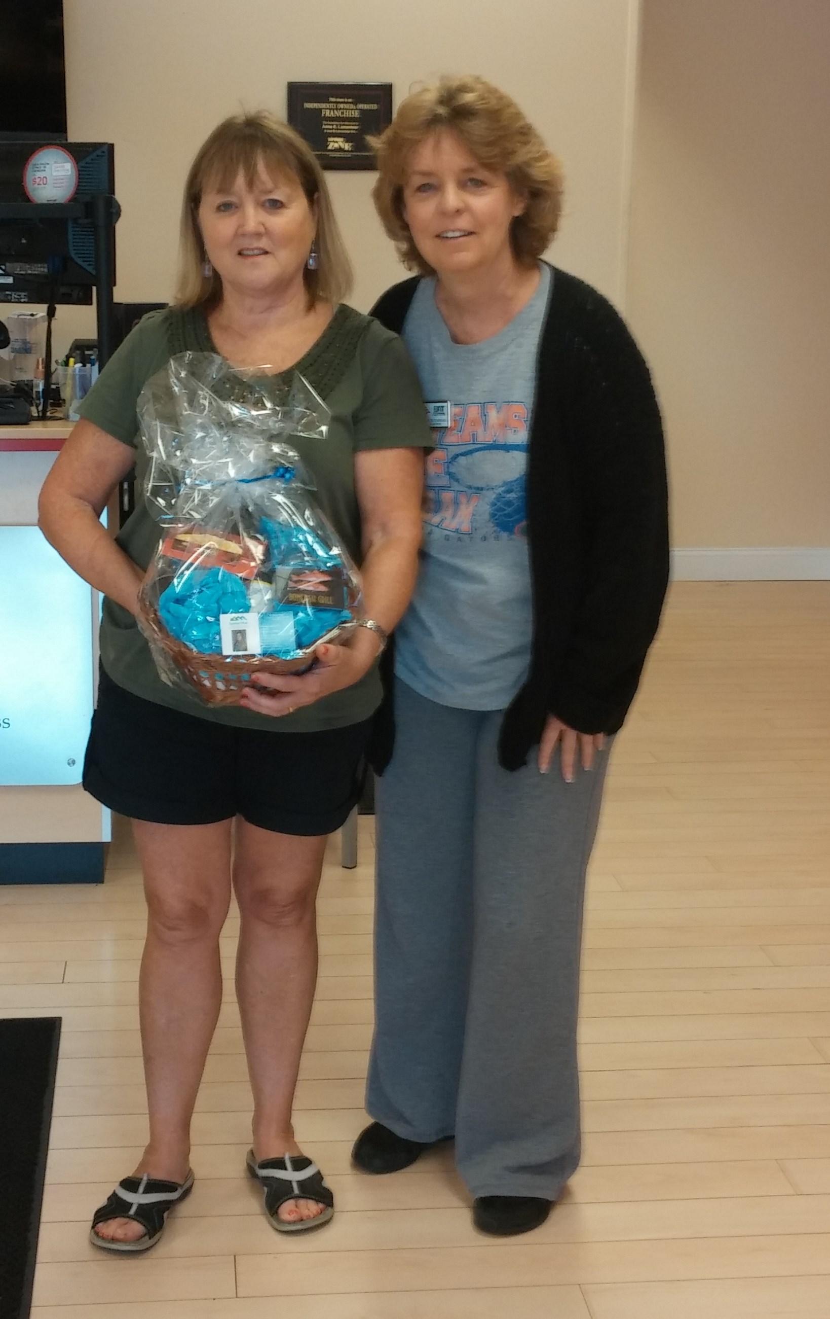 Judy Rothermel, Robin Eble Presenting the winnner Barbara George their Date night basket from the Taste of Medford