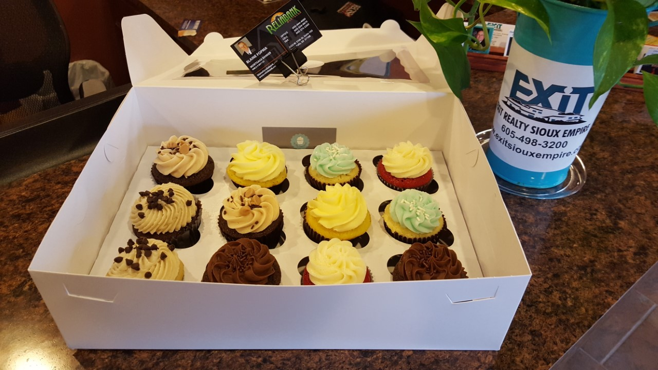 EXIT Realty Sioux Empire thanks Reliabank for Cupcakes