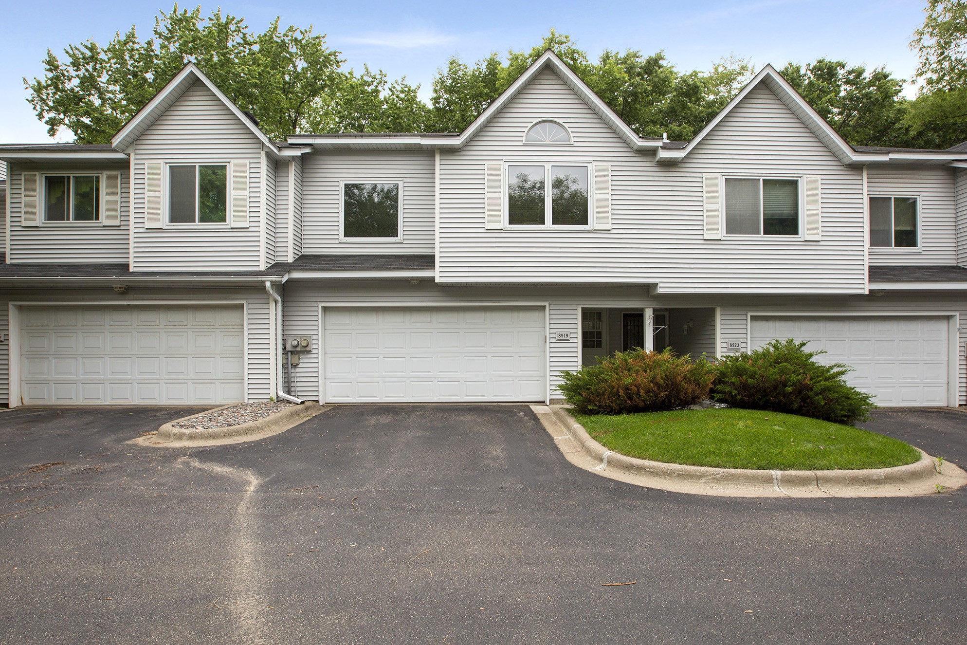 JUST LISTED! Coon Rapids townhome on wooded lot, under $150,000!